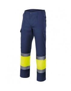 Pantalón bicolor de alta visibilidad con dos cintas reflectantes en las piernas y banda flúor entre ellas. Con pinzas, elástico
